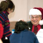 Art Roppi, of Naugatuck, shares a laugh while talking with a family during the Naugatuck Christmas Day Dinner Committee's annual Christmas dinner in 2011 at St. Michael's Episcopal Church in Naugatuck. This year's dinner will be held Wednesday from 12 to 2 p.m. at the church. –RA ARCHIVE