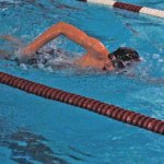 Naugatuck's Mitchell Santos races to victory in the 500 freestyle Tuesday night in Naugatuck versus Woodland. –KEN MORSE