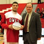 Keene State College mens basketball coach Rob Colbert presents senior Anthony Mariano, a graduate of Naugatuck High School, with his 1,000th point career ball Jan. 12. –MICHELLE BERTHIAUME