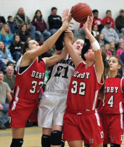 Naugatuck's Amy Dietz (21) battles for a rebound with Shelby Mendiloo (33) and Julie Butler (32) of Derby Jan. 25 in Naugatuck. Dietz had 18 points and 10 rebounds as the Greyhounds won, 68-37. –ELIO GUGLIOTTI
