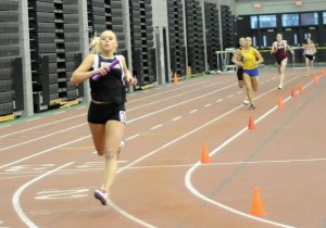Woodland's Tayler Boncal crosses the finish line in the 4-by-200 Tuesday at the Naugatuck Valley League indoor track championships in New Haven. The team of Boncal, Jiye Park, Steph Dumond and Megan Lynch won first in the event as the girls won the championship for the second year in a row. –LUKE MARSHALL