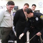 Canine Pete, a narcotics detecting Black Labrador, is pictured above with handler Naugatuck police Officer Kevin Zainc demonstrating his ability to sniff out drugs at a Board of Education meeting in December 2011. Pete is retiring after five years with the department. –FILE PHOTO