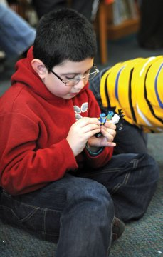 Jacob Flores, 9, from Beacon Falls creates a rover out of Legos during the Beacon Falls Public Library's Legos in the Library program Feb. 13. –LUKE MARSHALL