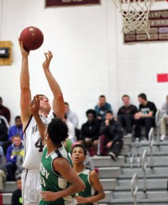 Naugatuck senior Brandon Kuczenski (42) gives the Greyhounds a strong presence in the middle as they head into the Class L tournament. –FILE PHOTO