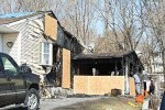 Garage fire spreads to home
