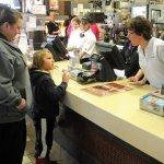 Hop Brook Elementary School first grade teacher Debbie Langdon, right, chats with first-grader Geno D'Errico and his mother, Vanessa D'Errico, at the McDonald's on New Haven Road in Naugatuck Feb. 21. Staff from Hop Brook worked at the restaurant for the Parent-School Association's McEducators night. A portion of the sales that evening went to the PSA. The organization raised $275.-LUKE MARSHALL