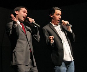 Naugatuck High School guidance counselor Matt Rosen, left, as 'Jimmy Fallon' and Troy Bond, a junior, as 'Justin Timberlake' perform the 'History of Rap' during the 4th Annual Rip the Runway Fashion Show March 14 at the school. –ELIO GUGLIOTTI