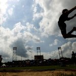 A silhouetted Mike Lang of Woodland High sails through the air during the long jump at the State Open Track and Field meet at Willow Brook Park June 3. Lang competed in the New England championships in the long and triple jumps and also finished seventh at the state decathlon last Wednesday. –RA ARCHIVE