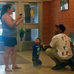 Renato Valderrama, 31, proposes to his girlfriend, Kelly Winterhalder, 24, at 10:20 a.m. Friday inside the lobby at Long River Middle School in Prospect. Valderrama asked Winterhalder to marry him at the time their son, Eli, turned 1 years old. –CONTRIBUTED