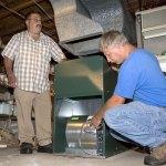 Dan Gentile, left, and Scott Fabianski install a new furnace at Robert Juliano's home in Naugatuck Wednesday. –RA ARCHIVE