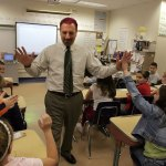 Joseph Nuzzo, principal of Community School in Prospect, high fives students in 2006 after dyeing his hair pink as a reward for students he challenged to collect Pennies for Patients Drive to benefit Leukemia and Lymphoma fund raiser. Nuzzo is retiring at the end of October. –RA ARCHIVE