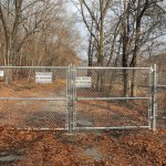 A locked gate blocks public access to the Naugatuck State Forest at the end Cold Spring Road in Beacon Falls last year. The road will be reopened Wednesday. –FILE PHOTO