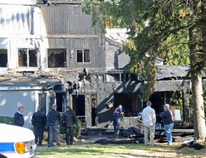 Fire officials work at the scene following a fire at 2 Summit Road Oct. 29 in Prospect. –FILE PHOTO