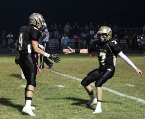 Woodland's Tanner Kingsley (7), Mike Kenney (9) and the Hawks face Morgan in the quarterfinals of Class S football playoffs Tuesday night in Beacon Falls. –FILE PHOTO