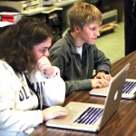 Woodland Regional High School freshman Rebecca Sticco, left, and sophomore Jason Dupre work on a public service announcement for the Region 16 Community Prevention Task Force, also known as 2COM, in the Hawks Productions studio Dec. 2 at the high school in Beacon Falls. –ELIO GUGLIOTTI
