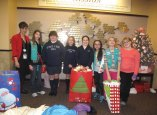 Naugatuck Junior Girl Scout Troop 64555 has earned the Bronze Award, which is a leadership adventure and the highest honor a Girl Scout Junior can achieve. For their Bronze Award project the girls chose to do a project to benefit cancer patients undergoing treatment. The girls learned how to finger knit so that they could make hats and held a month-long blanket drive to collect blankets. The troop received help from the fifth grade class at St. Francis-St. Hedwig School. Several troop members taught the class how to knit and they contributed their efforts to the project. The girls recently delivered 44 blankets and 12 hats to the Harold Leever Cancer Center in Waterbury. The girls will receive their Bronze Awards at a ceremony in the spring. Pictured, from left, Harold Leever Center Center representative Deborah Parkinson, Girls Scouts Samantha Klubek, Sage Hovanec, Abby Shugdinis, Sarah Orcutt, Faith Arcuri, Samantha Argel and Madeline Abate. –CONTRIBUTED