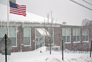 Wind and snow swirl Feb. 13 in front of Community School in Prospect as schools were closed for the day. The amount of days cancelled so far in Region 16, which oversees schools in Beacon Falls and Prospect, means two days of April vacation will be school days. –ELIO GUGLIOTTI