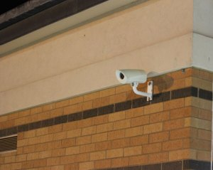 A surveillance camera watches over the parking lot at Long River Middle School in Prospect.  –FILE PHOTO