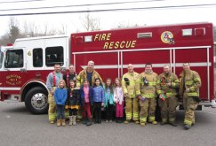 Girl Scouts from Troop 67821 held their first cookie booth March 22 at Beacon Falls Pharmacy. While the girls were selling cookies Beacon Hose Company No. 1 answered a fire call. When the firefighters returned and finished cleaning their gear, they visited the booth in uniform and bought cookies from the girls. -CONTRIBUTED