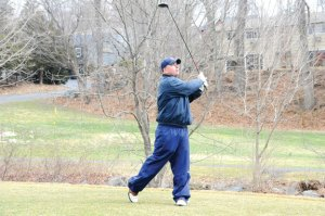 Daryl McKernan of Naugatuck watches his tee shot on the first hole at Hop Brook Golf Course Monday. The course is now open for the season. –LUKE MARSHALL