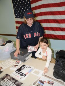 Naugatuck residents Mary Harris and her daughter Rikki Harris look over informational pamphlets about veterans at the American Legion Post 17 April 7. Mary and Rikki Harris are collecting clothing for homeless veterans and raising awareness about the plight of veterans struggling with post-traumatic stress disorder as part of the 'I'm Listening, I Care' program. –LUKE MARSHALL