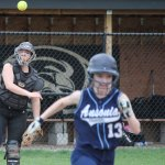 Woodland catcher Rachel Starkey throws to first in time to get out Ansonia's Kassie Tamburrino (13) Monday afternoon in Beacon Falls. The Hawks beat the Chargers, 3-0. –ELIO GUGLIOTTI