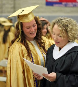 Woodland Regional High School Class of 2014 President Caroline Ecke, left, goes over her speech with English teacher Meghan Hatch-Geary before graduation June 20 at the school in Beacon Falls. –ELIO GUGLIOTTI