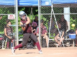 Naugatuck's Erica Bohuski connects with a pitch June 2 versus Windsor during the Class L tournament in Naugatuck. Naugatuck lost the game, 4-3, in eight innings. –ELIO GUGLIOTTI