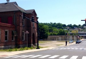 The property shown here is known as Parcel C in downtown Naugatuck. The building here, known as Building 25, will be torn down next month and two developers plan to build a medical office complex and restaurant on the site. –RA ARCHIVE