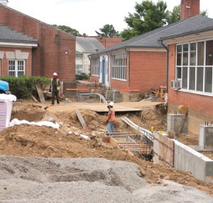 Crews work in the courtyard of Laurel Ledge Elementary School in Beacon Falls Aug. 21 laying the groundwork for new corridors to connect the buildings. –ELIO GUGLIOTTI