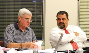 Board of Finance members Dan Sheridan, left, and Andrew Bottinick look over the budget during Thursday's Joint Boards of Finance and Mayor and Burgess meeting. The joint boards approved a $113.8 million budget for 2014-15, which will go to a public hearing on Monday. –LUKE MARSHALL