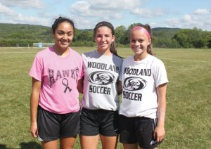 Woodland girls soccer captains, from left, junior Alexa Casimiro and seniors Marisa Macek and Rosalina Santos will lead the Hawks on the pitch this season. –ELIO GUGLIOTTI