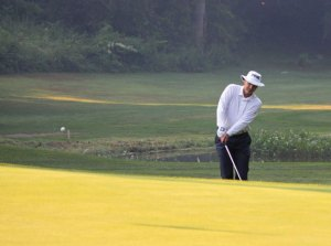 Ray Martino putts on the first green during the Hop Brook Men's Club Championship at Hop Brook Golf Course in Naugatuck last year. Martino defeated Scott Thomas, eight and seven, to win the championship for the third time in the past four years. Martino has won four Hop Brook Men's Club Championship in all. –FILE PHOTO
