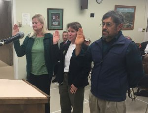 From left, Christine Yanelli, Melissa Leonard and Felipe Flores are sworn in by Mayor Robert Mezzo as new conservation commission members Nov. 4 at Naugatuck Town Hall. This is the first time Naugatuck has had a conservation commission, which will look to preserve open space and protect the environment in other ways. –REPUBLICAN-AMERICAN