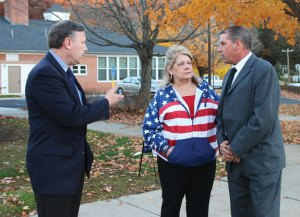 From left, Beacon Falls First Selectman Chris Bielik, Region 16 Board of Education Vice Chair Priscilla Cretella, and Selectman Peter Betkoski talk outside Laurel Ledge Elementary School on Tuesday during the municipal election. –LUKE MARSHALL