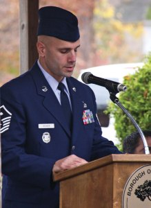 U. S. Air Force Master Sgt. David Bedner, the aerospace science instructor for the Air Force Junior ROTC at Naugatuck High School, addresses the crowd during Naugatuck's Veterans Day ceremony Nov. 11. Bedner was the keynote speaker at the ceremony. –LUKE MARSHALL