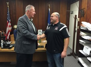 Naugatuck Mayor N. Warren 'Pete' Hess shakes hands with Roger Simoes of Naugatuck Youth Soccer Wednesday after Hess handed him $10,000 for the league. The money, collected by Hess and other local attorneys, helped the league replace goal posts that had been stolen. -REPUBLICAN-AMERICAN
