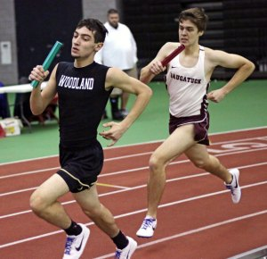 Woodland's Paul Jones stays a few steps ahead of Naugatuck's David Kerns in the 4x800 during the NVL indoor track championship Monday at the Floyd Little Athletic Center in New Haven. –LUKE MARSHALL