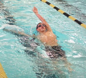 Naugatuck's Evan Bomberry does the backstroke during the 200 individual medley versus Woodland Jan. 20 in Beacon Falls. Naugatuck won the meet, 92-83. –ELIO GUGLIOTTI