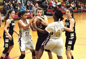 Woodland's Morina Bojka (22) battles for possession of the ball with Sacred Heart's Vanessa Riddick (21) and Mahnue Sahn (41) as her teammates Maddie Hupprich (4) and Carla Piccolo (10) back her up Monday night in Waterbury. Woodland won the game, 37-30. –KEN MORSE
