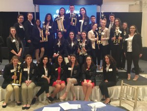 Members of the Naugatuck High School DECA chapter pose for a photo after the state DECA competition March 1 at the Aqua Turf Club in Plantsville. –CONTRIBUTED