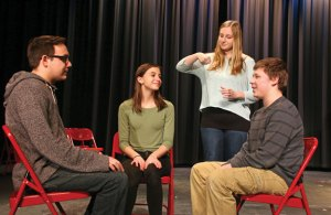 Woodland Regional High School drama club members, from left, Matthew LaPorta, Christina Vlamis, Sydney Sills and Riley Clark rehearse a scene March 24 from the club's upcoming production of 'Our Town.' The play opens April 8. –LUKE MARSHALL