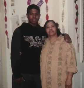 Torrance Dawkins, left, who grew up in Naugatuck and Waterbury, was 22 when he was murdered in New Haven in 2013. He is seen here with his paternal grandmother, Gloria Garcia, who says she prays for her grandson's killer. -CONTRIBUTED