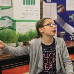 Prospect Elementary School third-grader Molly Stead explains her science project during the 21st annual Science Fair at the school April 15. Stead's experiment determined which grass seed will grow the tallest grass in three weeks. –ELIO GUGLIOTTI