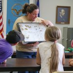 Amber McDonald, an educator from the Flanders Nature Center and Land Trust in Woodbury, shows examples of preserved bugs during the Insect Investigation program co-sponsored by the Beacon Falls Library and the Beacon Falls Parks and Recreation Department April 22 in Beacon Falls. –LUKE MARSHALL