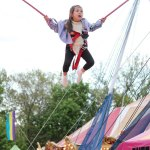 Aliyana Aspipi, 5, of Naugatuck, bounces around on a trampoline during the Coleman Brothers Carnival May 19 in Naugatuck. The carnival was sponsored by the Naugatuck Education Foundation, a nonprofit organization that provides grants for education programs in borough schools that aren't funded through the annual school budget. A portion of the proceeds from the carnival went to the NEF. –ELIO GUGLIOTTI