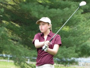 Naugatuck's Madison Brink watches her shot during the Greyhounds Girls Invitational Tuesday at Hop Brook Golf Course in Naugatuck. -REPUBLICAN-AMERICAN