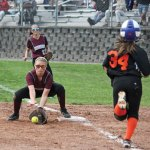 Naugatuck's Mckenzi Staples scoops up a throw to first to get the force out on Watertown's Chloe DeFeo (34) Saturday in Naugatuck. Watertown won the game, 8-5. –ELIO GUGLIOTTI