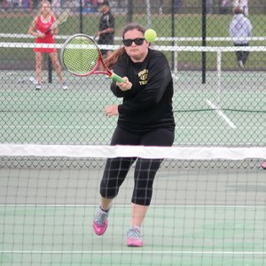 Woodland's Katie Rioux returns a shot versus Wolcott April 29 in Beacon Falls. Wolcott won the match, 4-3. –ELIO GUGLIOTTI