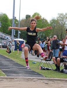 Woodland's Ava Capuano and the Hawks enter the NVL championship May 24 among the top contenders to win the boys and girls track titles. –FILE PHOTO